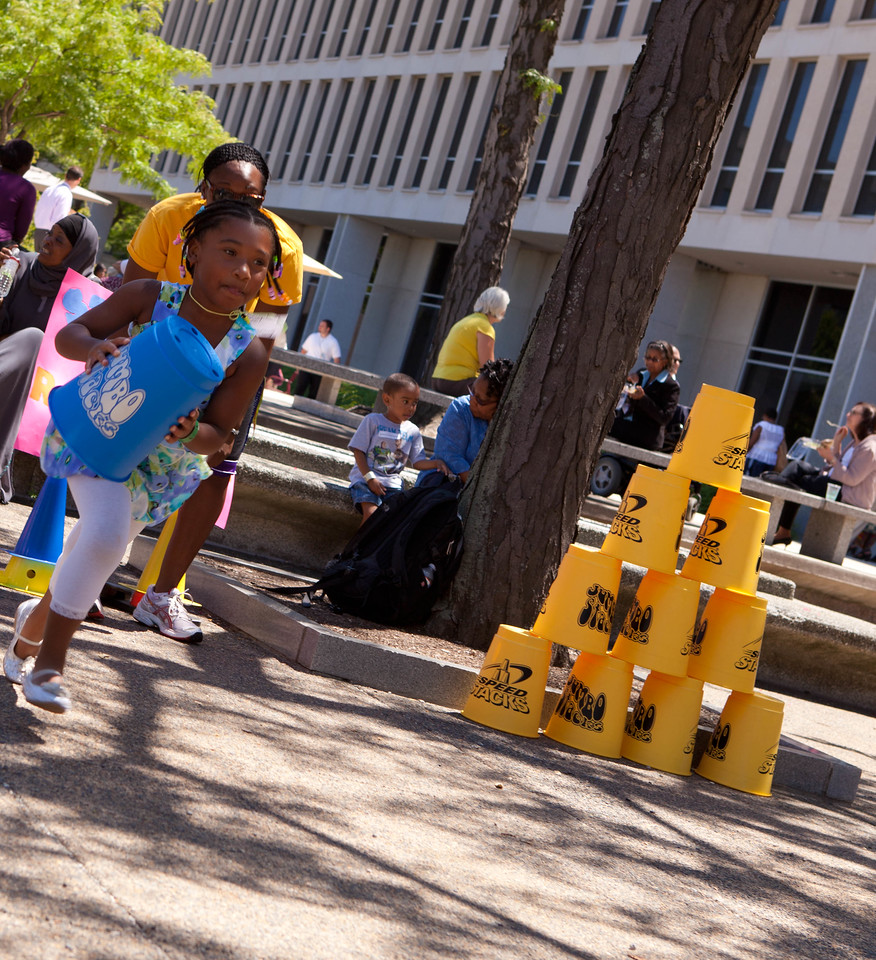 Child participating in an obstacle course at The Department of Education event for Let's Read. Let's Move. Corporation for National and Community Service Photo.