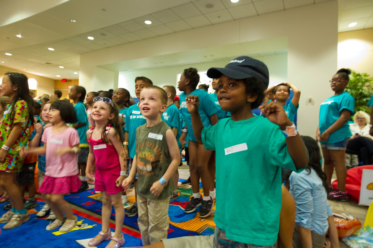 Children listening at a reading at The Department of Education event for Let's Read. Let's Move. Corporation for National and Community Service Photo.