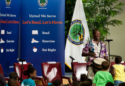 Wolf Trap Teaching Artist Kofi Dennis playing music for children at Let's Read Let's Move July 2012. Corporation for National and Community Service Photo.