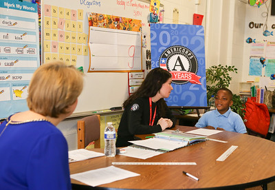 CNCS CEO Wendy Spencer observes a reading intervention facilitated by AmeriCorps member and Metro DC Reading Corps tutor, Sabrina Poms at C.W. Harris Elementary School in Washington, D.C. Corporation for National and Community Service Photo.