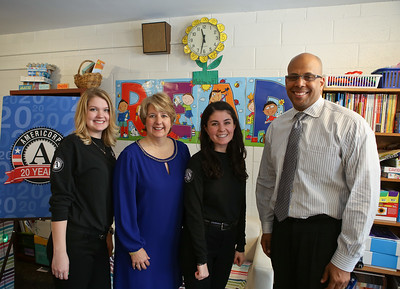 AmeriCorps member and Metro DC Reading Corps tutor, Allison McCoy, CNCS CEO Wendy Spencer, AmeriCorps member and Metro DC Reading Corps tutor, Sabrina Poms and Deputy Secretary of Education Jim Shelton at C.W. Harris Elementary School. Corporation for National and Community Service Photo.