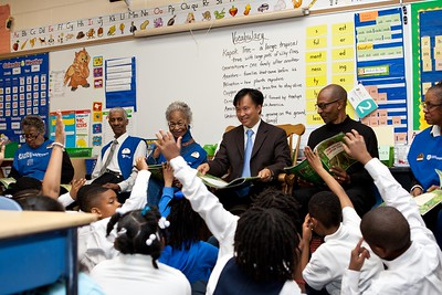 Students participate in a book reading with Foster Grandparents and Director of Senior Corps, Dr. Erwin Tan at Miner Elementary School. Corporation for National and Community Service Photo.
