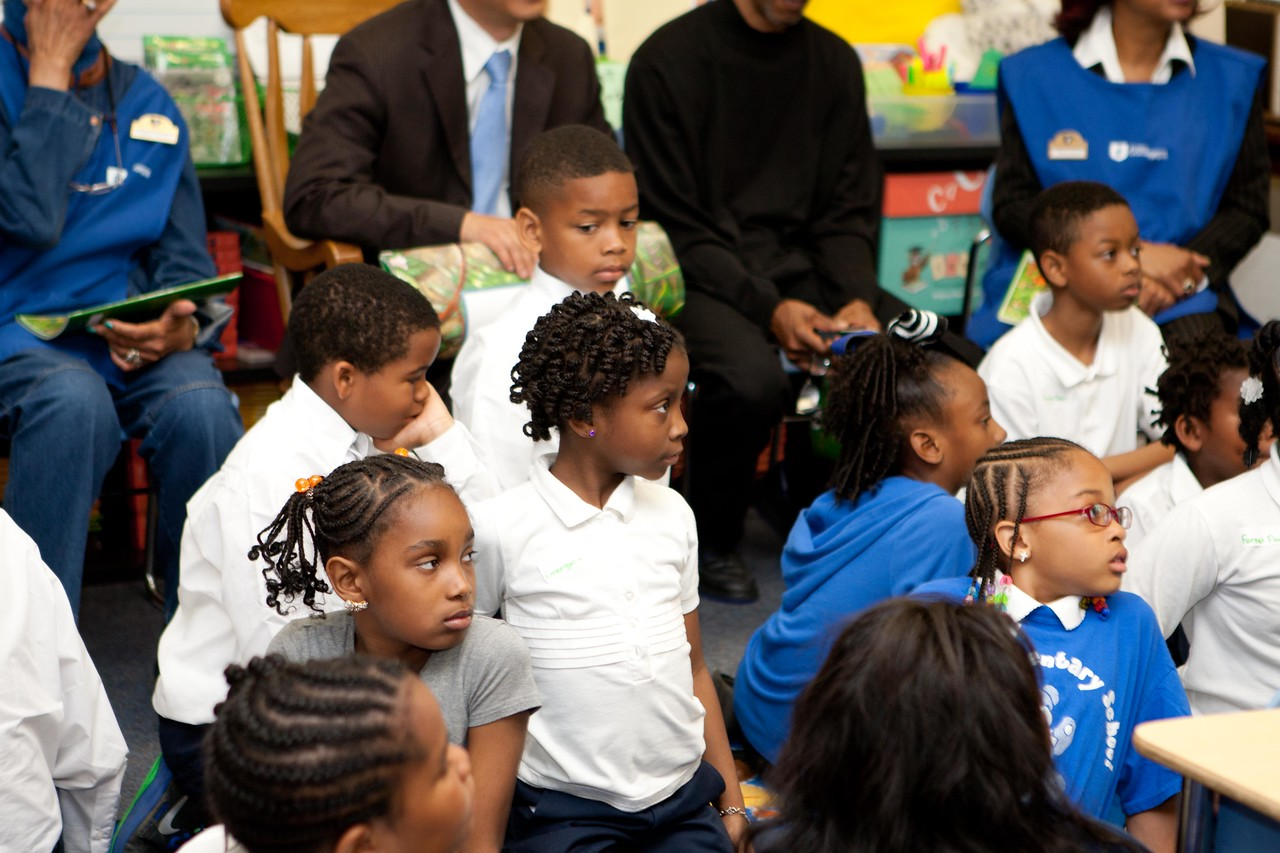 Students listening to the book reading at Miner Elementary School in Washington, D.C. as Foster Grandparents and Director of Senior Corps, Dr. Erwin Tan read about the rain forest at Miner Elementary School. Corporation for National and Community Service Photo.