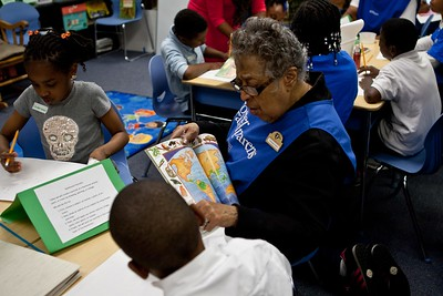 A Foster Grandparent assist students with an arts project at Miner Elementary School in Washington, D.C. Corporation for National and Community Service Photo.