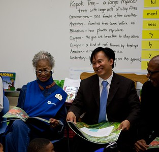Foster Grandparent Thelma and Director of Senior Corps, Dr. Erwin Tan reading to students at Miner Elementary School. Corporation for National and Community Service Photo.