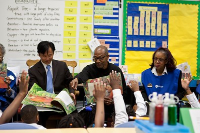 Foster Grandparents and Director of Senior Corps, Dr. Erwin Tan reading to students at Miner Elementary School. Corporation for National and Community Service Photo.