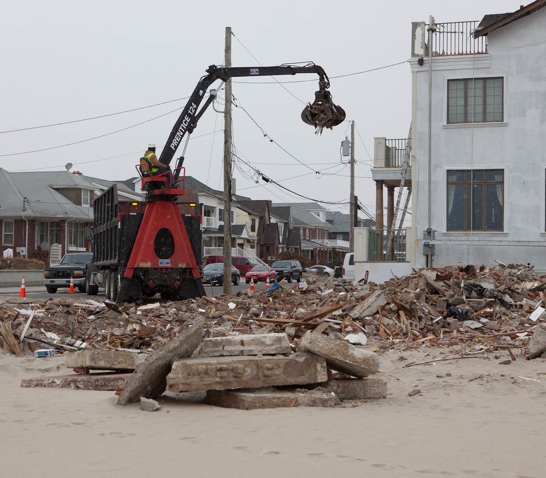 Crane and construction workers helping to rebuild homes affected by Hurricane Sandy at Rockaway Beach, NY.  Corporation for National and Community Service Photo.Corporation for National and Community Service Photo.