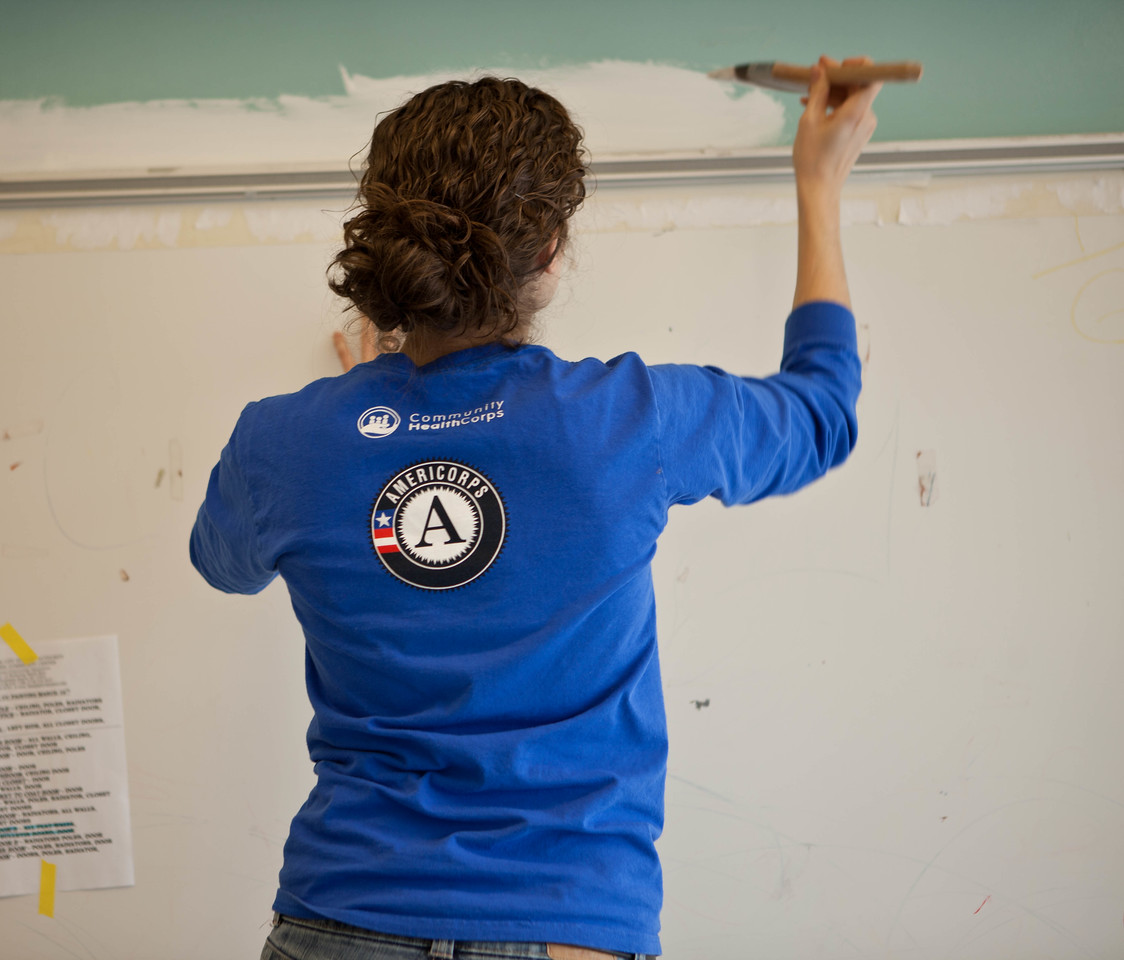 AmeriCorps member painting the Hammel House community center. Corporation for National and Community Service Photo.