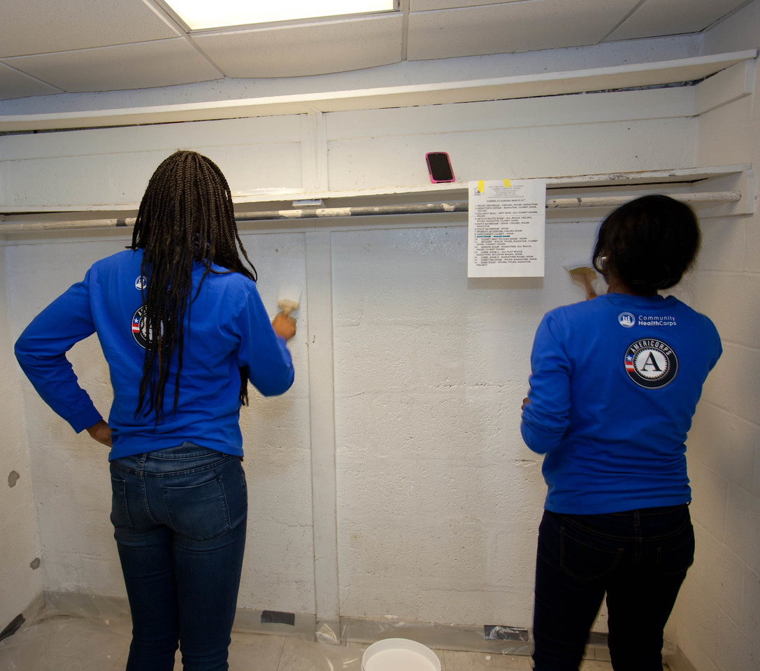 AmeriCorps members painting the Hammel House community center. Corporation for National and Community Service Photo.
