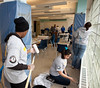 AmeriCorps members paint the Hammel House Community Center in Far Rockaway, NY on March 16, 2013. (Corporation for National and Community Service Photo)