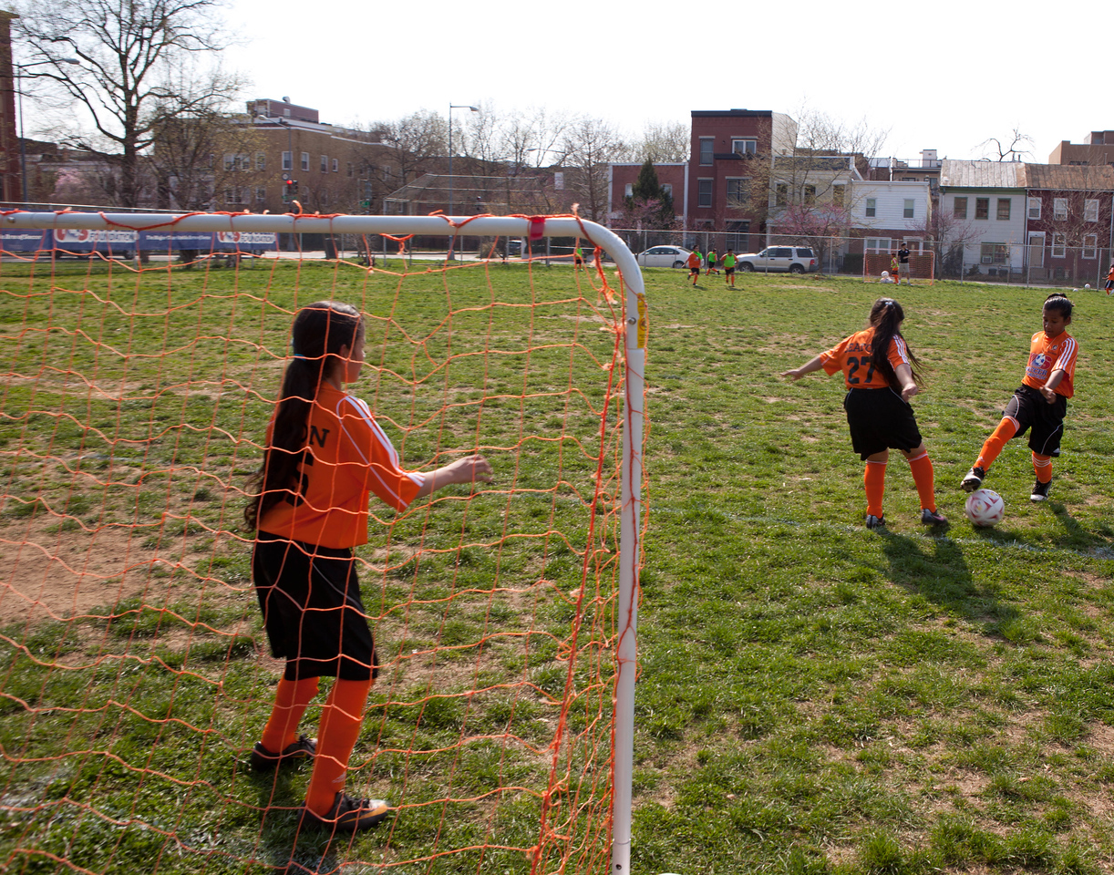 Children on the Seaton Elementary soccer squad in Washington, DC, practice for an upcoming game in April 2012. The school has 32 children that participate in the DC SCORES program, which combines academic studies with exercise through soccer. (Corporation for National and Community Service photo)