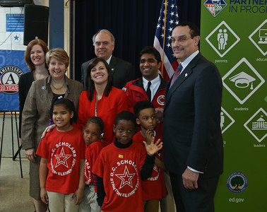 CNCS CEO, Wendy Spencer, Director of AmeriCorps Bill Basl and Washington, D.C. Mayor Vincent Gray alongside students and a teacher from DC Scholars Stanton Elementary in Washington, D.C. Corporation for National and Community Service photo