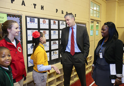 Students and an AmeriCorps City Year member speak with Secretary of Education Arne Duncan and Stanton DC Scholars Elementary Principal Rena Johnson. Corporation for National and Community Service photo