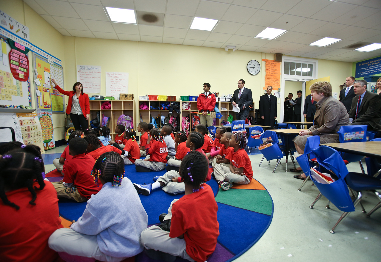 An AmeriCorps City Year member leads a class while guests Mayor Vincent Gray, CNCS CEO Wendy Spencer and Secretary of Education Arne Duncan listen in at DC Scholars Stanton Elementary in Washington, D.C. Corporation for National and Community Service photo