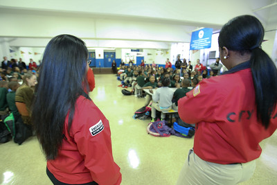 AmeriCorps City Year members organize students for an assembly at DC Scholars Stanton Elementary in Washington, D.C. Corporation for National and Community Service photo