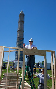 Director of AmeriCorps, Bill Basl framing a house at the Veterans Build on the Mall 2013. Corporation for National and Community Service Photo.