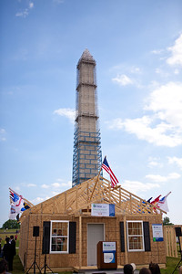 Washington Monument and Habitat home built during Veterans Build on the Mall 2013. Corporation for National and Community Service Photo.