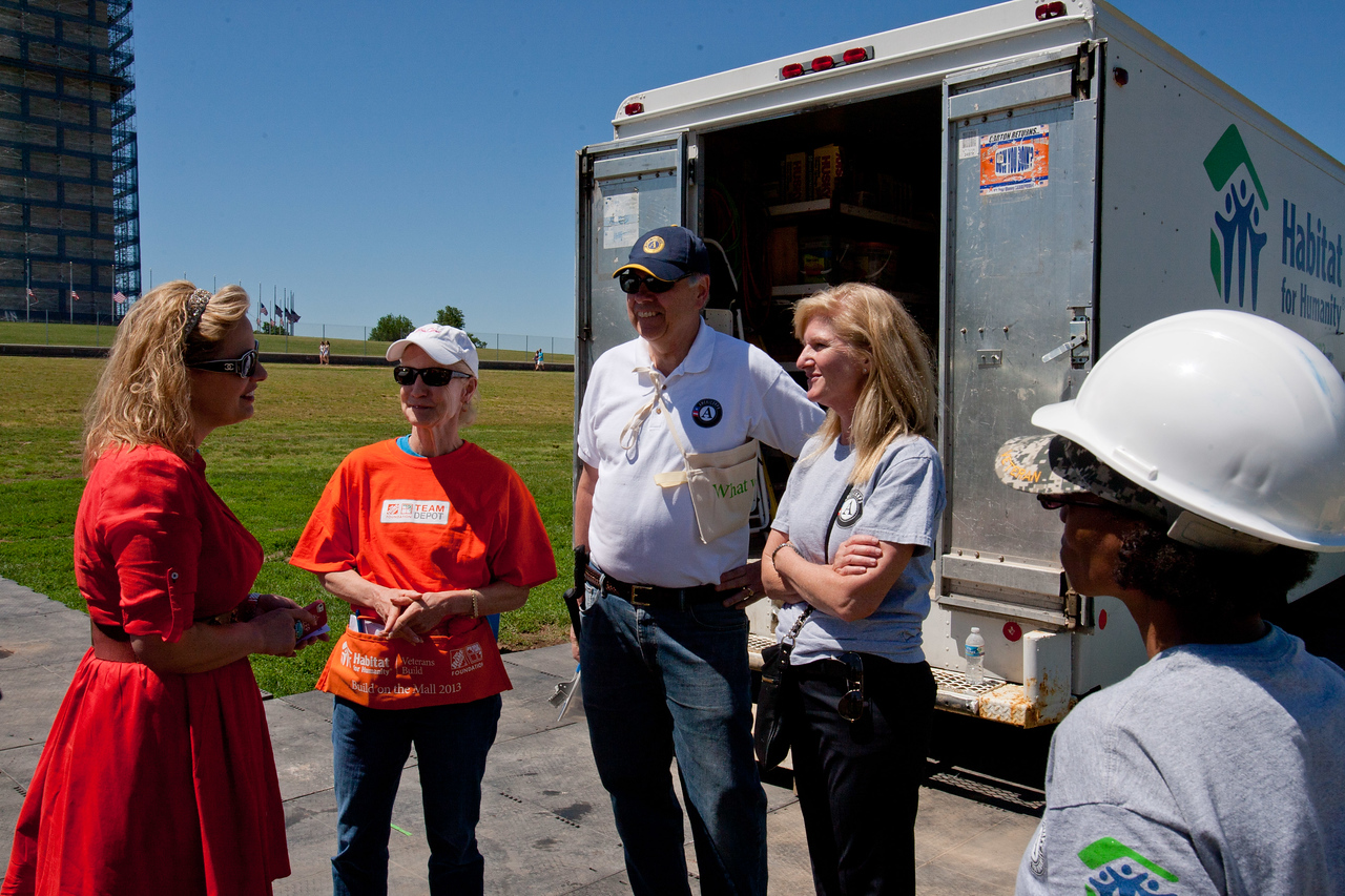 Rep. Kyrsten Sinema (AZ) speaking with senior vice president, Government Affairs, Advocacy and General Counsel, Liz Blake, Director of AmeriCorps, Bill Basl and Director, Office of Government Relations, Kim Allman.  Corporation for National and Community Service Photo.