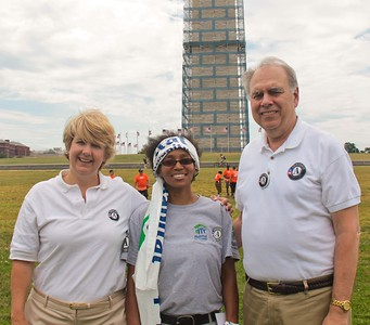 Corporation for National and Community Service CEO Wendy Spencer (left) and Director of AmeriCorps Bill Basl pause for a photo with Regina Best, a U.S. Air Force veteran serving with Habitat for Humanity through AmeriCorps during the Veterans Habitat Build-a-Thon on the National Mall on June 2, 2013. Best overcame homelessness after her military service and now helps others though Habitat for Humanity. (Corporation for National and Community Service Photo)