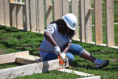 AmeriCorps member framing the national service house at the Veterans Build on the Mall 2013. Corporation for National and Community Service Photo.