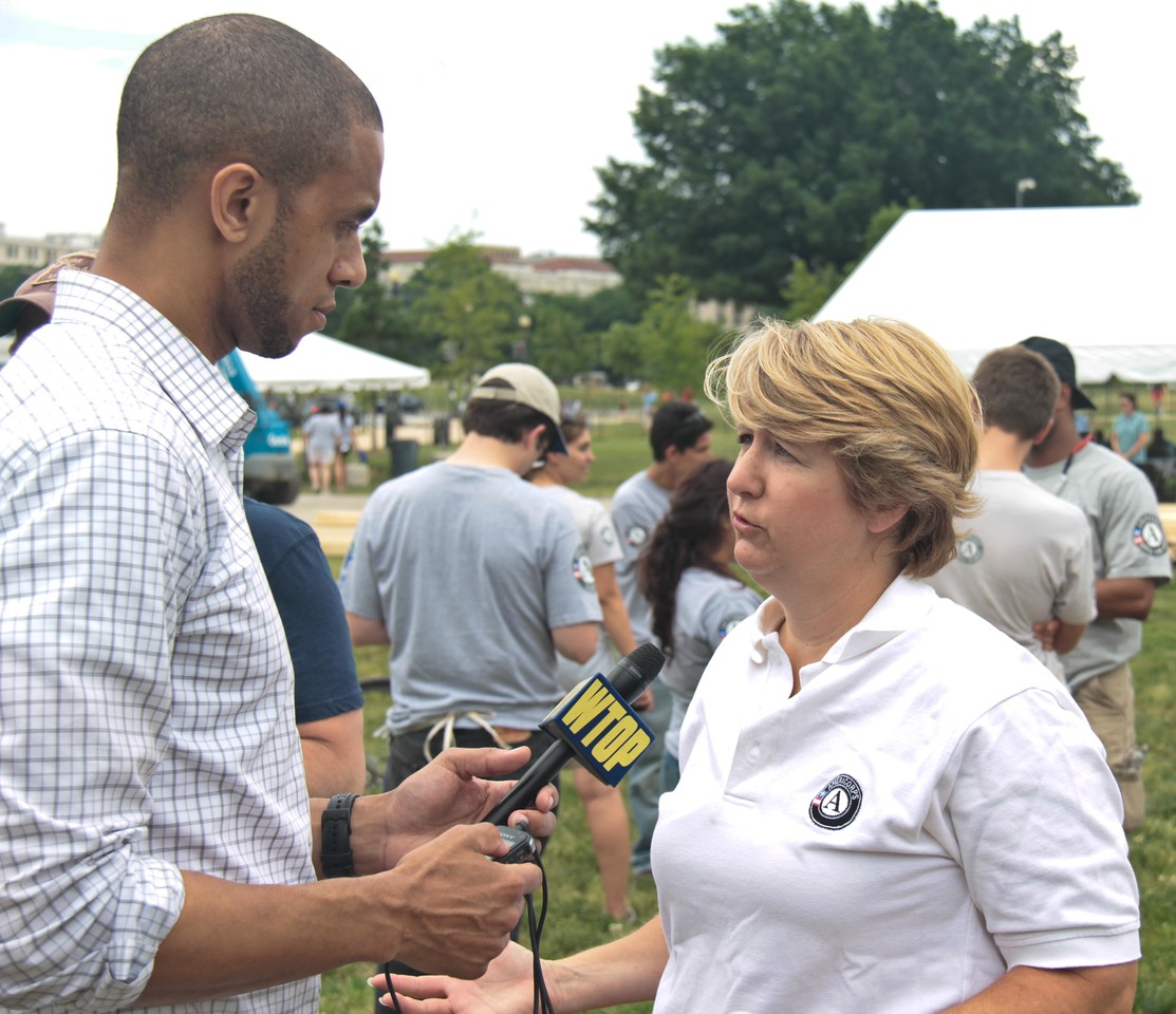 CNCS, CEO Wendy Spencer being interviewed by WTOP at the Veterans Build on the Mall 2013. Corporation for National and Community Service Photo.