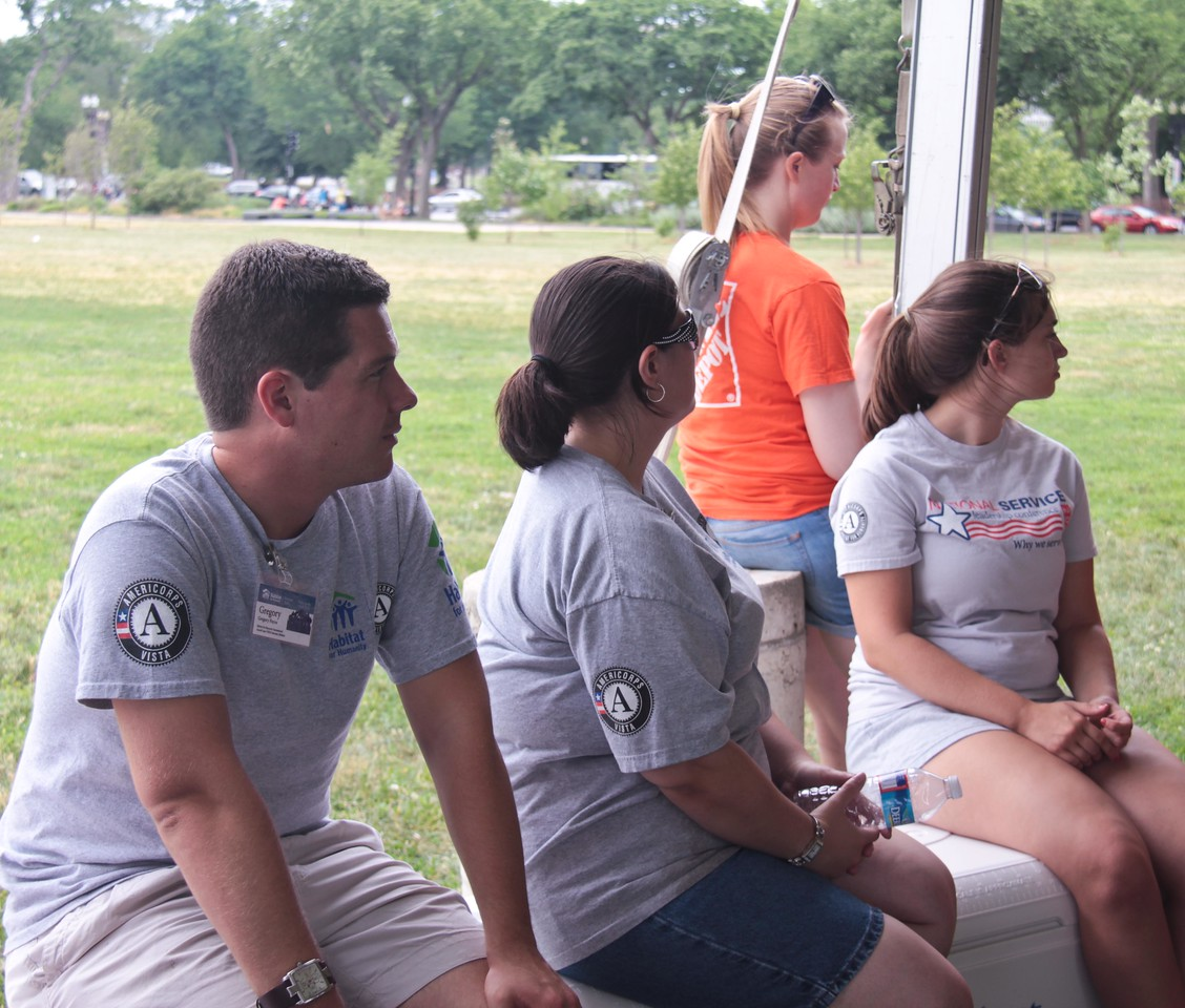 AmeriCorps members listens to speakers at the kick-off to the Veterans Build on the Mall 2013. Corporation for National and Community Service Photo.