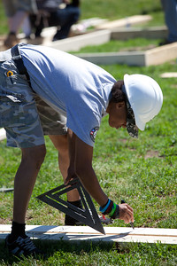 AmeriCorps member, Regina Best squares a 2x4 before framing at the Veterans Build on the Mall 2013. Corporation for National and Community Service Photo.