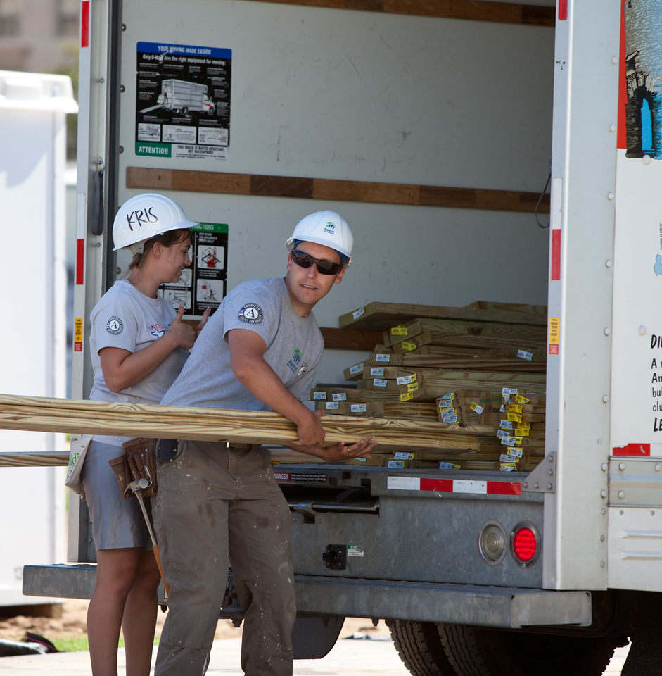 AmeriCorps members unloading materials at the Veterans Build on the Mall 2013. Corporation for National and Community Service Photo.