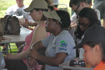An AmeriCorps member listens to speakers at the kick-off to the Veterans Build on the Mall 2013. Corporation for National and Community Service Photo.
