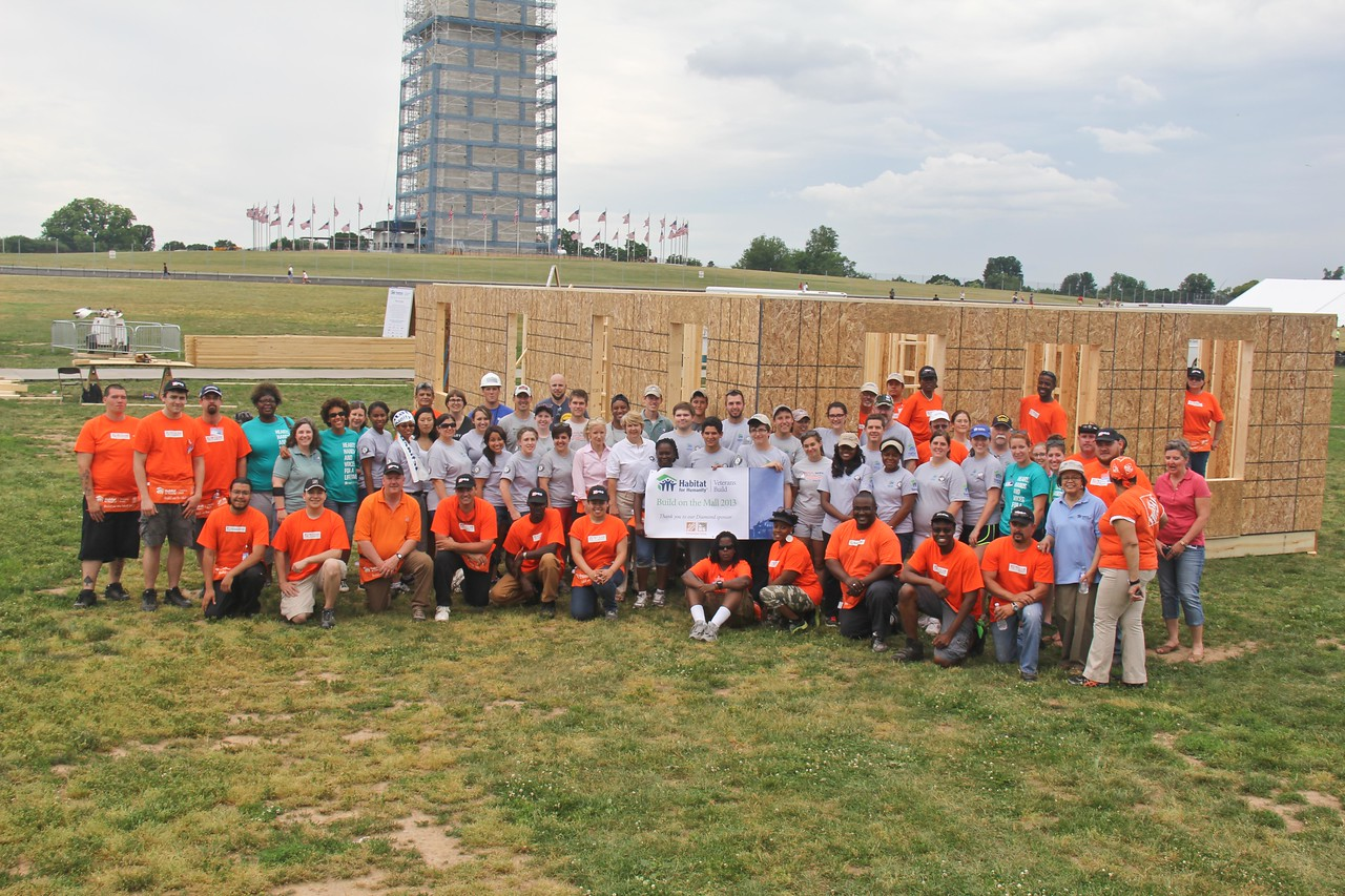 AmeriCorps members alongside Home Depot volunteers and CNCS, CEO Wendy Spencer with Director or AmeriCorps, Bill Basl at the Veterans Build on the Mall 2013. Corporation for National and Community Service Photo.