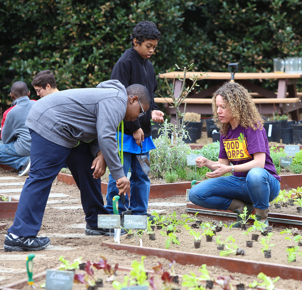 Food Corps member with students planting vegetables at the White House Kitchen Garden. Corporation for National and Community Service Photo.