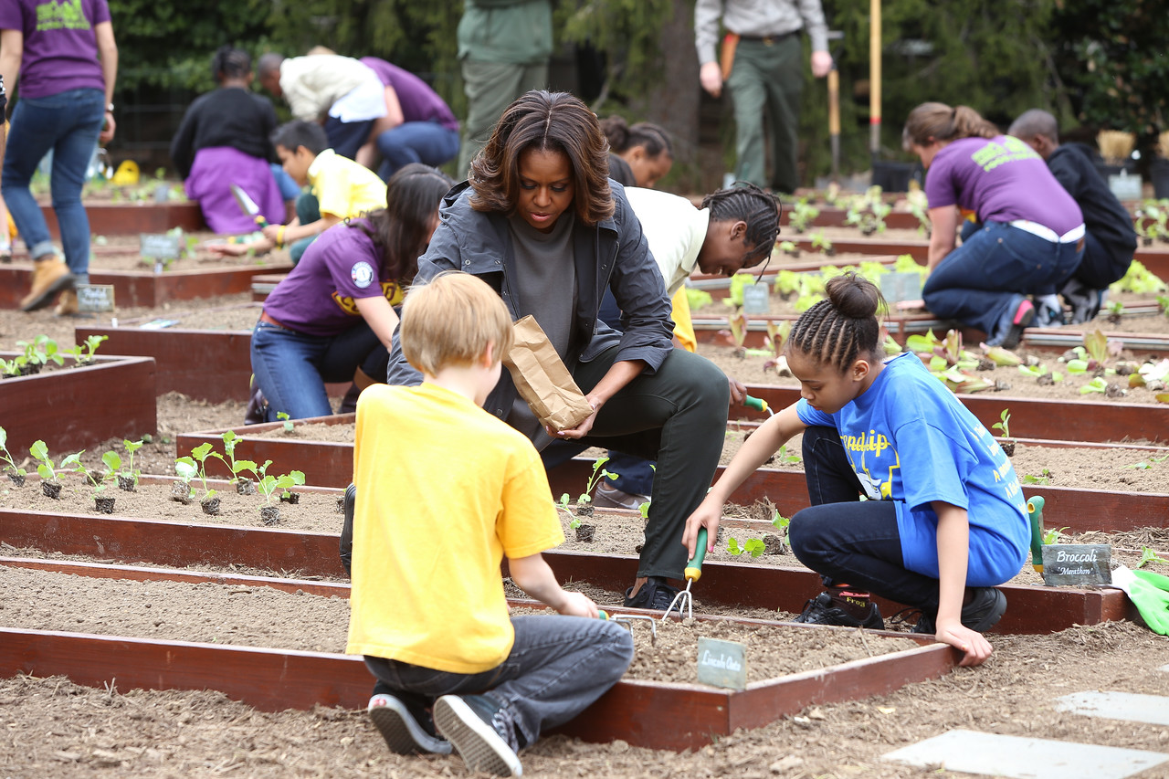 First Lady Michelle Obama plants vegetables with students on the South Lawn. Corporation for National and Community Service Photo.