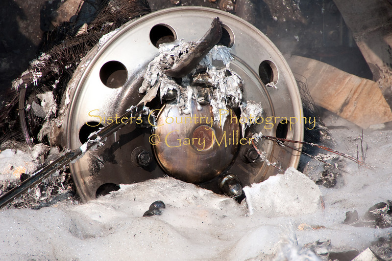 A nearly new Class 'A' Motorhome towing a recreational vehicle burned to a melted skeleton of metal near the Mt. Washington viewpoint on the Highway 20's Santiam Pass near Sistere, OR on September 24th, 2009. The melted front right wheel covered with foam is a telling story of the total destruction.