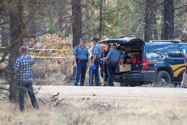 Police personnel gather at the scene  of a fatal shooting of a vehicle pursuit suspect on August 30, 2013 on Harrington Loop just outside of Sisters, Oregon. Copyright © 2013 Gary N. Miller, Sisters Country Photography
