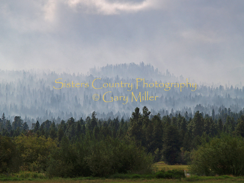 "The weather clears mid-morning after 1/4"" of rain stops the GW fire in it's tracks, saving Black Butte Ranch from devastation. GW Fire - Sisters, OR"