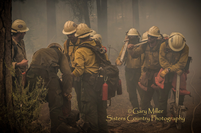 Members of the Mid-Plains Interagency Handcrew pictured here were part of a team perfoming back-fire burnout  operations on July 9th. The Green Ridge Fire was a lightning caused wildfire located on the east wall Green Ridge in the Metolius Basin just north of Camp Sherman, Oregon near the Allingham Guard Station. The fire started on July 31, 2013 and was taken over by the NorCal Team 1 as part of the Cascade DIvision complex of lightning fires on August 3, 2013. Copyright © 2013 Gary N. Miller, Sisters Country Photography
