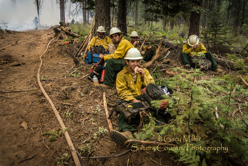 Fire crews working on back-fire burnout  operations July 9th. The Green Ridge Fire was a lightning caused wildfire located on the east wall Green Ridge in the Metolius Basin just north of Camp Sherman, Oregon near the Allingham Guard Station. The fire started on July 31, 2013 and was taken over by the NorCal Team 1 as part of the Cascade DIvision complex of lightning fires on August 3, 2013. Copyright © 2013 Gary N. Miller, Sisters Country Photography
