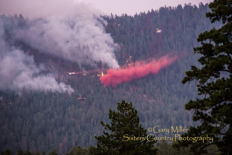 Stretching the last of the late day light (and the photographer's skills and equipment capabilities) the last air tanker streaks through on it's final retardant drop of the day tries to help the night crew hold the lines before heading off to their base of operations in Redmond. The Green Ridge Fire was a lightning caused wildfire located on the east wall Green Ridge in the Metolius Basin just north of Camp Sherman, Oregon near the Allingham Guard Station. The fire started on July 31, 2013 and was taken over by the NorCal Team 1 as part of the Cascade DIvision complex of lightning fires on August 3, 2013. Copyright © 2013 Gary N. Miller, Sisters Country Photography