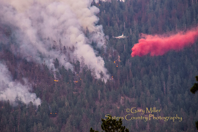 The Green Ridge Fire was a lightning caused wildfire located on the east wall Green Ridge in the Metolius Basin just north of Camp Sherman, Oregon near the Allingham Guard Station. The fire started on July 31, 2013 and was taken over by the NorCal Team 1 as part of the Cascade DIvision complex of lightning fires on August 3, 2013. Copyright © 2013 Gary N. Miller, Sisters Country Photography