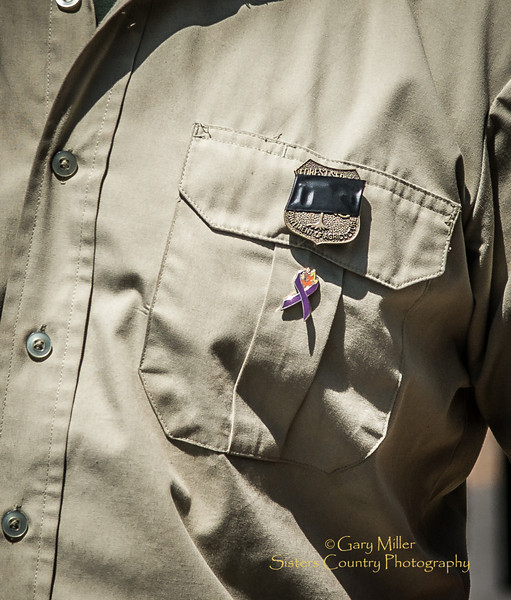 USFS FIrefighters taped their badges black in honor of John Hammack killed on the fire lines outside of Sisters, Oregon on  August 1, 2013 - Copyright © 2013 Gary N. Miller, Sisters Country Photography