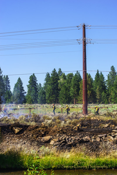 A wildland fire triggered by an electrical line malfunction threatened horses in a large stable operation on Perit-Huntington Road in Sisters, Oregon on July 25, 2013. The 3/4 acre fire was rapidly knocked down with no loss of life or property by a multi-agency response from USFS, ODF, Sisters-Camp Sherman and Cloverdale Fire Departments. Copyright © 2013 Gary N. Miller, Sisters Country Photography