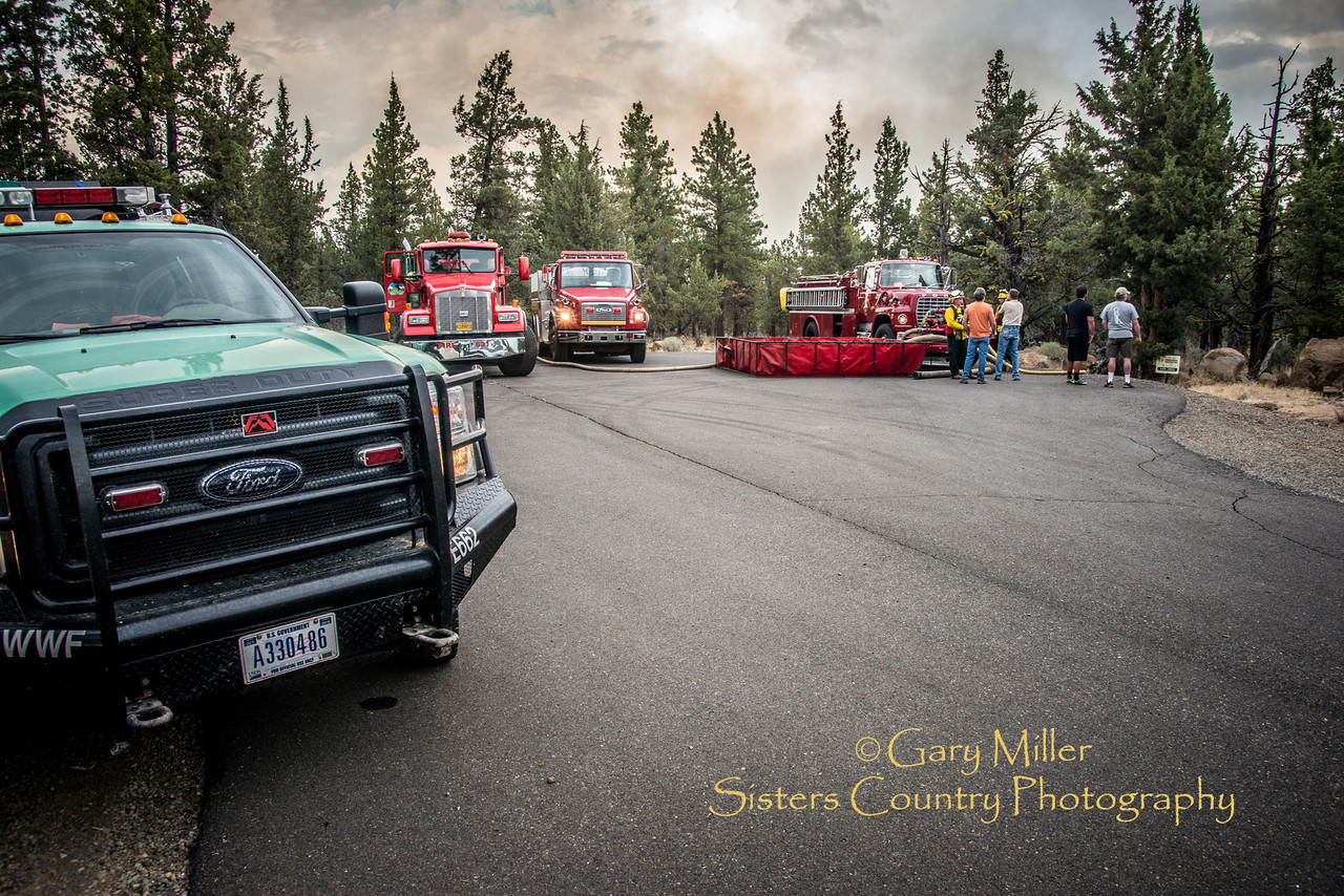 Air tankers and multi-agency fire crews fought Fire Incident 395 off of Mustang Rd. which threatened homes in Squaw Creek Canyon Estates after a lightning strike from a major storm cell that came over the Oregon Cascades on July 31, 2013. Copyright © 2013 Gary N. Miller, Sisters Country Photography