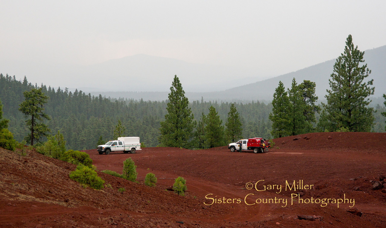 Fire lookouts watch from 4 Mile Butte as a lightning laden storm rolls through the Cascades west of Sisters, Oregon - Copyright © 2013 Gary N. Miller, Sisters Country Photography
