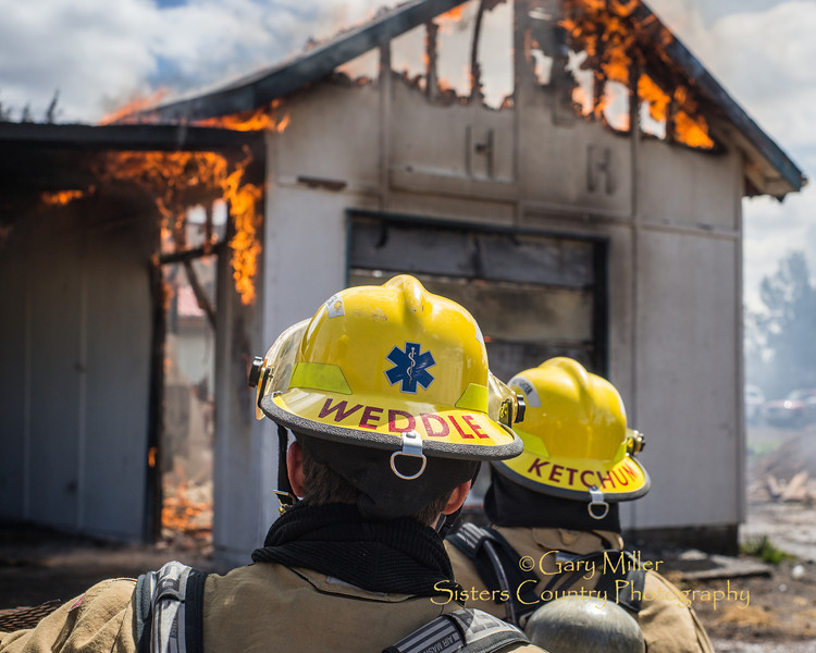 Image captured during a 'Burn to Learn' training exercise on Quail Tree Drive hosted by the Cloverdale Rural Fire Department. Participating Fire Department teams included Sisters-Camp Sherman FD, Black Butte Ranch FD and the Bend Fire Department. - April 27, 2014 © 2013 Gary N. Miller, Sisters Country Photography