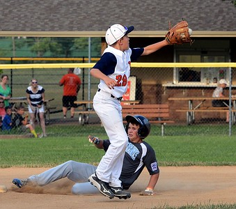 Justin Nicholas, of Deep Run, beats throw to Northampton's Chris Nowmos (#29).