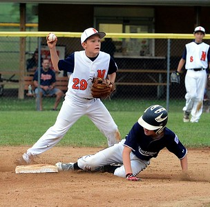 Chris Nowmos (#29), left, looks for second play after forcing Bernie Parent at second base.