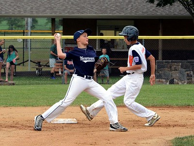 Josh Huddy, of Newtown, forces Shane Dawson at second base.