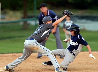 Holland's Max Walinsky, right, is forced out at second base.