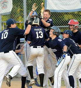 Newtown players celebrate Bernie Parent's leadoff homer against Warwick.