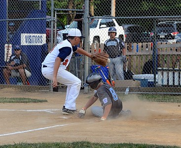 Justin Nichols (#8), right, scores on wild pitch as Noah Lackman covers home.